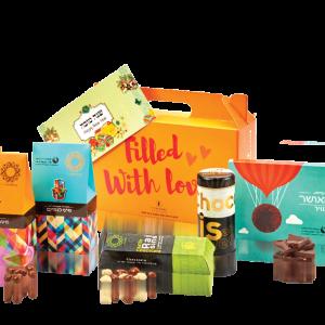 """""""בתרומה לקהילה""""- מארז מתנה לראש השנה הכולל שוקולדים ואגרת ברכת """"שנה טובה"""""""