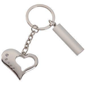 """מחזיק מפתחות לב עם """"חלון"""" בצורת לב ושורת יהלומים בצד"""
